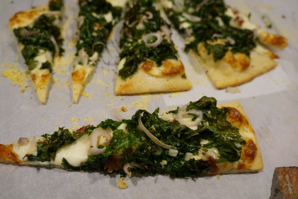 Kale pizza sliced